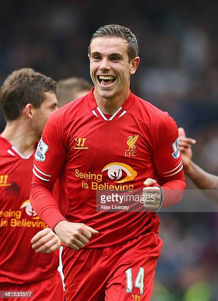 Jordan Henderson of Liverpool celebrates scoring the fourth goal during the Barclays Premier League match between Liverpool and Tottenham Hotspur at...