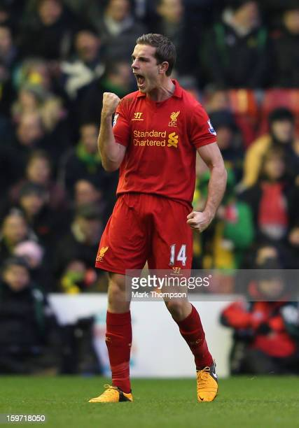 Jordan Henderson of Liverpool celebrates scoring the opening goal during the Barclays Premier League match between Liverpool and Norwich City at...