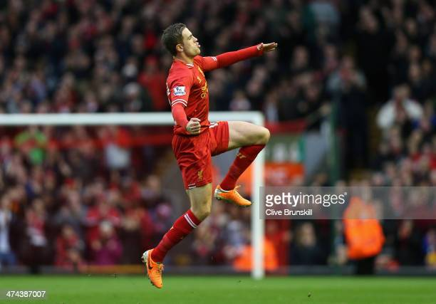 Jordan Henderson of Liverpool celebrates scoring the second goal during the Barclays Premier League match between Liverpool and Swansea City at...