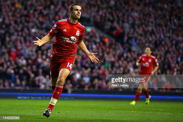 Jordan Henderson of Liverpool celebrates scoring their second goal during the Barclays Premier League match between Liverpool and Chelsea at Anfield...