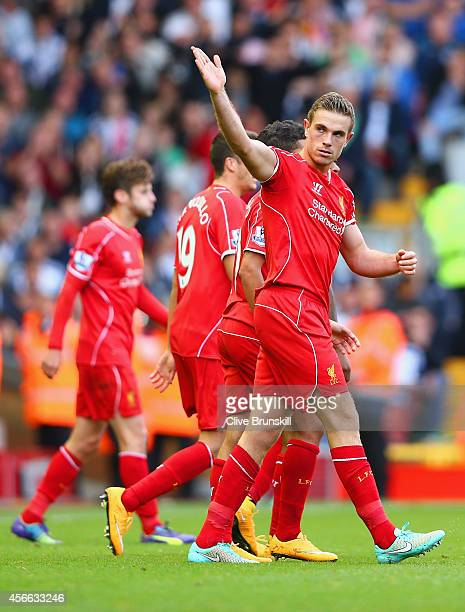 Jordan Henderson of Liverpool celebrates scoring their second goal during the Barclays Premier League match between Liverpool and West Bromwich...