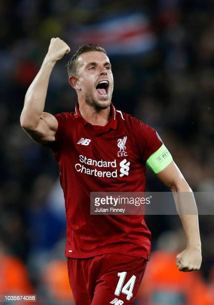 Jordan Henderson of Liverpool celebrates victory after the Group C match of the UEFA Champions League between Liverpool and Paris SaintGermain at...