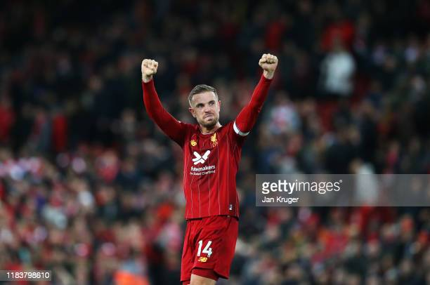 Jordan Henderson of Liverpool celebrates victory after the Premier League match between Liverpool FC and Tottenham Hotspur at Anfield on October 27,...