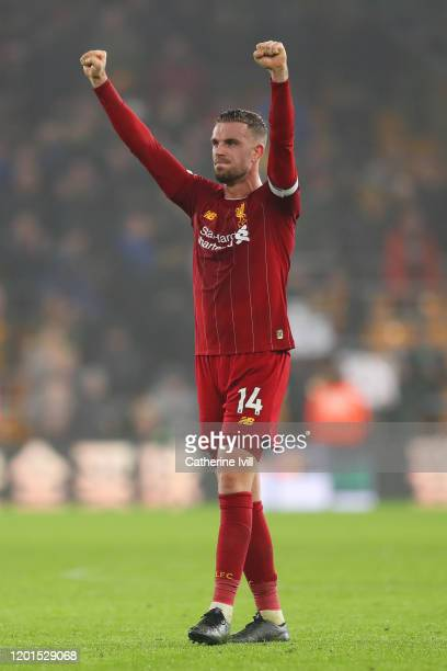 Jordan Henderson of Liverpool celebrates victory in the Premier League match between Wolverhampton Wanderers and Liverpool FC at Molineux on January...