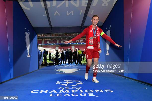Jordan Henderson of Liverpool celebrates victory with his winners medal in the tunnel after the UEFA Champions League Final between Tottenham Hotspur...