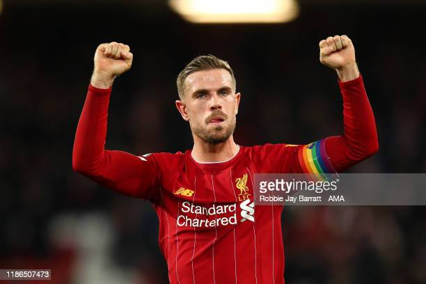 Jordan Henderson of Liverpool celebrates winning the Premier League match between Liverpool FC and Everton FC at Anfield on December 4 2019 in...