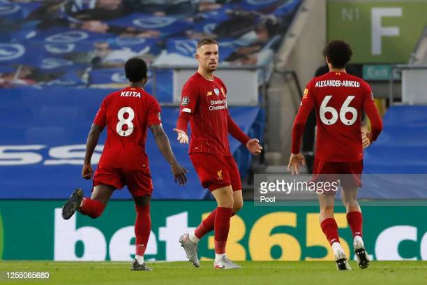 Jordan Henderson of Liverpool celebrates with his team after scoring his sides second goal during the Premier League match between Brighton & Hove...