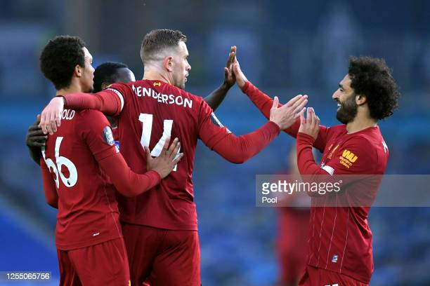 Jordan Henderson of Liverpool celebrates with his team after scoring his sides second goal during the Premier League match between Brighton Hove...
