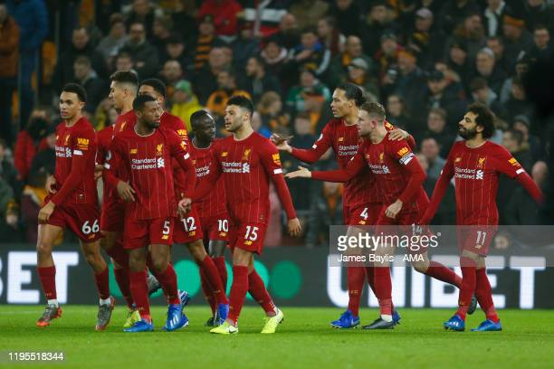 Jordan Henderson of Liverpool celebrates with his team mates after scoring a goal to make it 01 during the Premier League match between Wolverhampton...