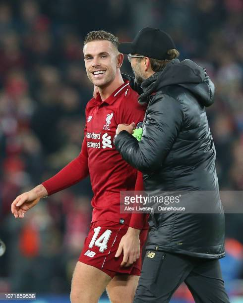 Jordan Henderson of Liverpool celebrates with Jurgen Klopp after the UEFA Champions League Group C match between Liverpool and SSC Napoli at Anfield...