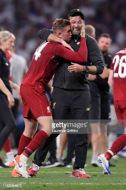 Jordan Henderson of Liverpool celebrates with Jurgen Klopp Manager of Liverpool following the UEFA Champions League Final between Tottenham Hotspur...