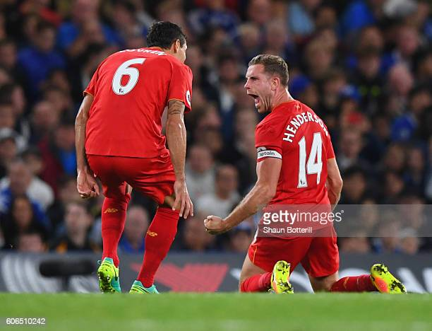 Jordan Henderson of Liverpool celebrates with team mate Dejan Lovren as he scores their second goal during the Premier League match between Chelsea...