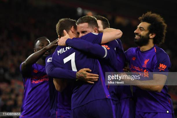 Jordan Henderson of Liverpool celebrates with team mates after scoring their team's third goal during the Premier League match between Southampton FC...