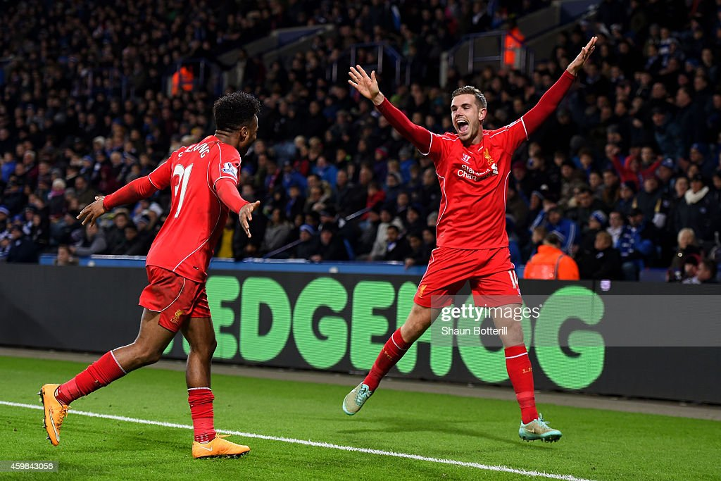 Jordan Henderson (R) of Liverpool celebrates with teammate Raheem Sterling of Liverpool after scoring his team's third goal during the Barclays Premier League match between Leicester City and Liverpool at The King Power Stadium on December 2, 2014 in Leicester, England.
