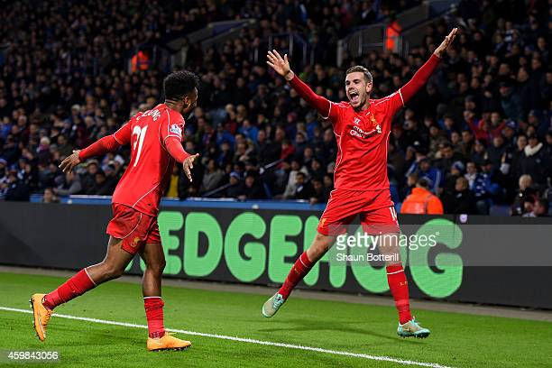 Jordan Henderson of Liverpool celebrates with teammate Raheem Sterling of Liverpool after scoring his team's third goal during the Barclays Premier...