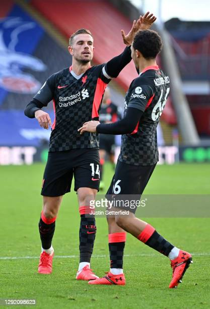 Jordan Henderson of Liverpool celebrates with teammate Trent Alexander-Arnold after scoring their sides fourth goal during the Premier League match...