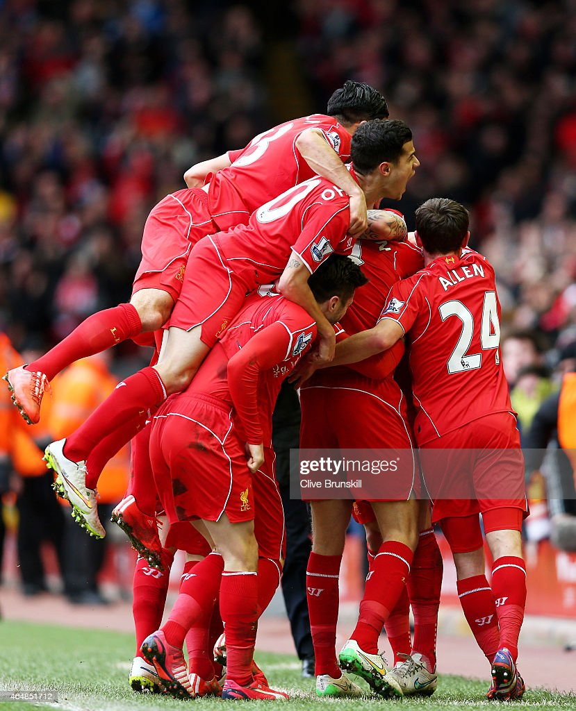 Jordan Henderson (obscured) of Liverpool celebrates with teammates after scoring the opening goal during the Barclays Premier League match between Liverpool and Manchester City at Anfield on March 1, 2015 in Liverpool, England.