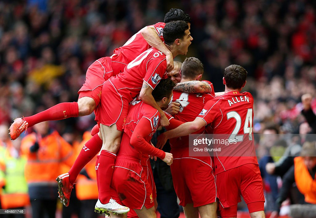 Jordan Henderson (2nd R) of Liverpool celebrates with teammates after scoring the opening goal during the Barclays Premier League match between Liverpool and Manchester City at Anfield on March 1, 2015 in Liverpool, England.