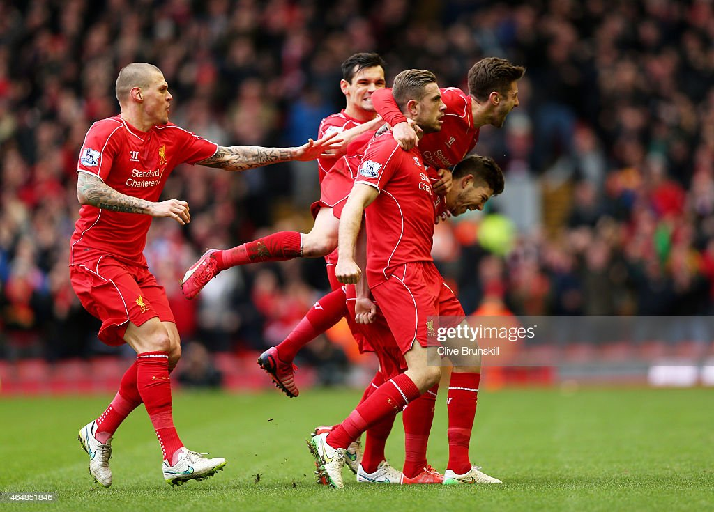 Jordan Henderson (C) of Liverpool celebrates with teammates after scoring the opening goal during the Barclays Premier League match between Liverpool and Manchester City at Anfield on March 1, 2015 in Liverpool, England.