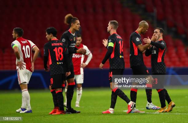 Jordan Henderson of Liverpool celebrates with teammates at fulltime after the UEFA Champions League Group D stage match between Ajax Amsterdam and...