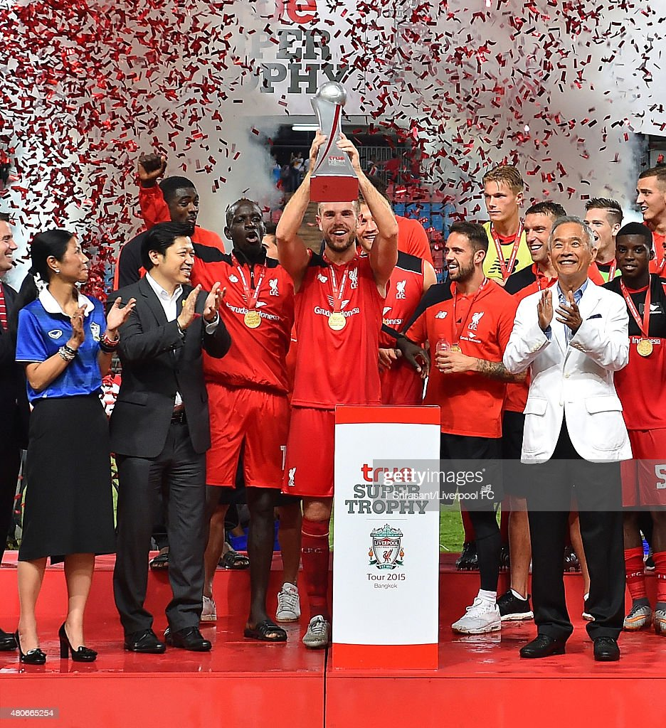 Jordan Henderson #14 of Liverpool celebrates with the trophy during the international friendly match between Thai Premier League All Stars and Liverpool FC at Rajamangala Stadium on July 14, 2015 in Bangkok, Thailand.