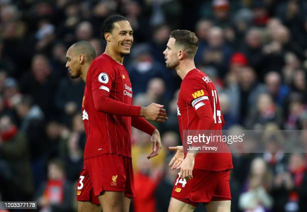 Jordan Henderson of Liverpool celebrates with Virgil van Dijk after scoring his team's second goal during the Premier League match between Liverpool...