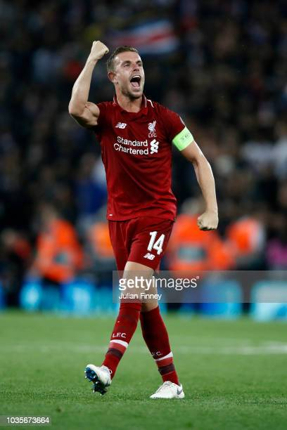 Jordan Henderson of Liverpool celerbates victory after the Group C match of the UEFA Champions League between Liverpool and Paris SaintGermain at...