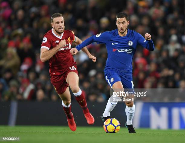 Jordan Henderson of Liverpool chases down Eden Hazard of Chelsea during the Premier League match between Liverpool and Chelsea at Anfield on November...