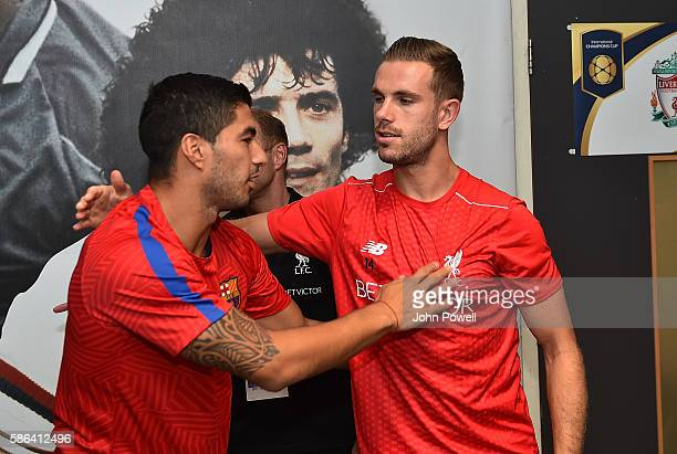Jordan Henderson of Liverpool chat with Luis Suarez of Barcelona before the International Champions Cup match between Liverpool and Barcelona at...