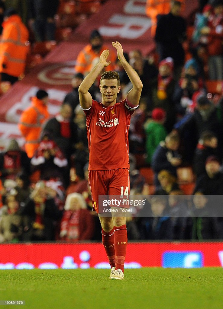 Jordan Henderson of Liverpool claps to the fans at then end of the Barclays Premier League match between Liverpool and Swansea City at Anfield on December 29, 2014 in Liverpool, England.