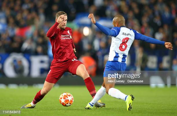 Jordan Henderson of Liverpool competes for the ball with Yacine Brahimi of Porto during the UEFA Champions League Quarter Final first leg match...