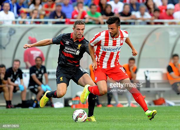 Jordan Henderson of Liverpool competes with Andreas Samaris of Olympiacosduring the International Champions Cup match between Liverpool and...