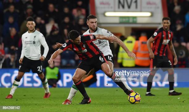 Jordan Henderson of Liverpool competes with Andrew Surman of AFC Bournemouth during the Premier League match between AFC Bournemouth and Liverpool at...