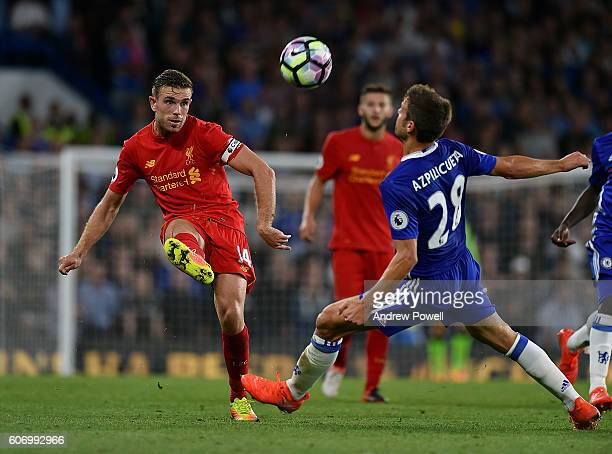 Jordan Henderson of Liverpool competes with Cesar Azpilicueta of Chelsea during the Premier League match between Chelsea and Liverpool at Stamford...