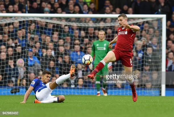 Jordan Henderson of Liverpool competes with Dominic CalvertLewin of Everton during the Premier League match between Everton and Liverpool at Goodison...