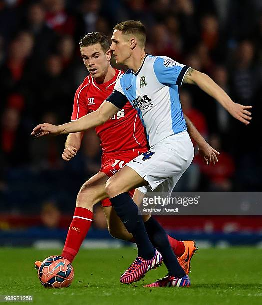 Jordan Henderson of Liverpool competes with Matt Kilgallon of Blackburn Rovers during the FA Cup Quarter Final Replay match between Blackburn Rovers...
