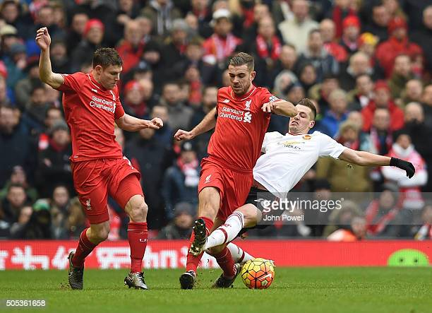 Jordan Henderson of Liverpool competes with Morgan Schneiderlin of Manchester United during the Barclays Premier League match between Liverpool and...