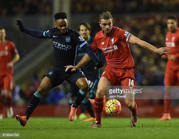 Jordan Henderson of Liverpool competes with Raheem Sterling of Manchester City during the Barclays Premier League match between Liverpool and...