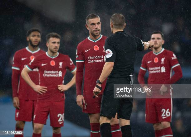 Jordan Henderson of Liverpool complains to the referee Craig Pawson after he awards a penalty for handball during the Premier League match between...