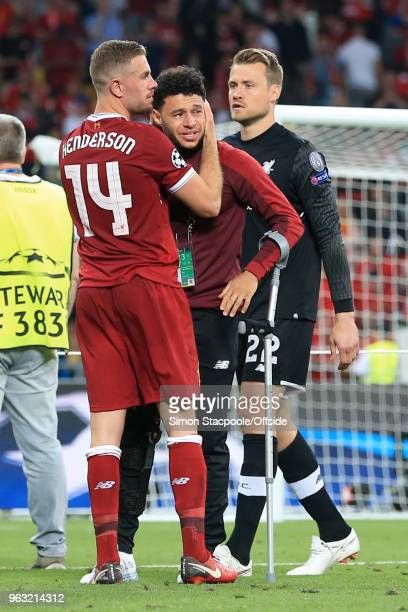 Jordan Henderson of Liverpool consoles injured teammate Alex OxladeChamberlain of Liverpool who is on crutches after the UEFA Champions League Final...