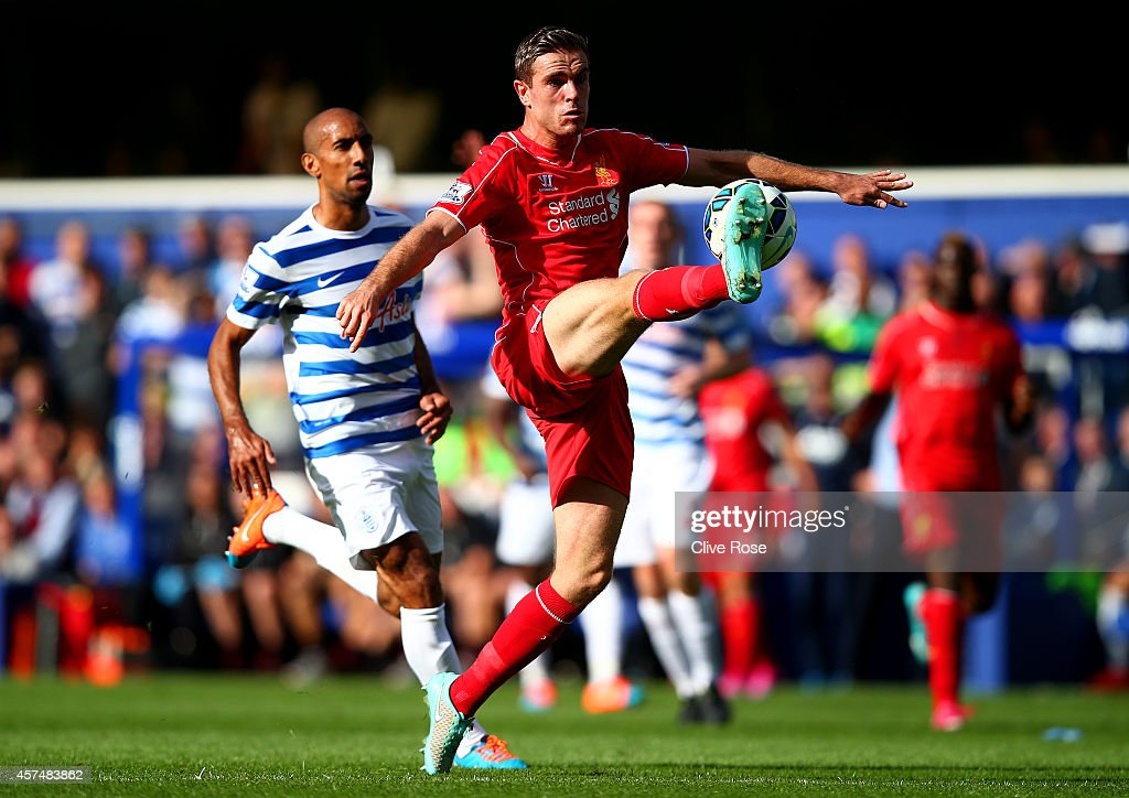 Jordan Henderson of Liverpool controls the ball during the Barclays Premier League match between Queens Park Rangers and Liverpool at Loftus Road on October 19, 2014 in London, England.