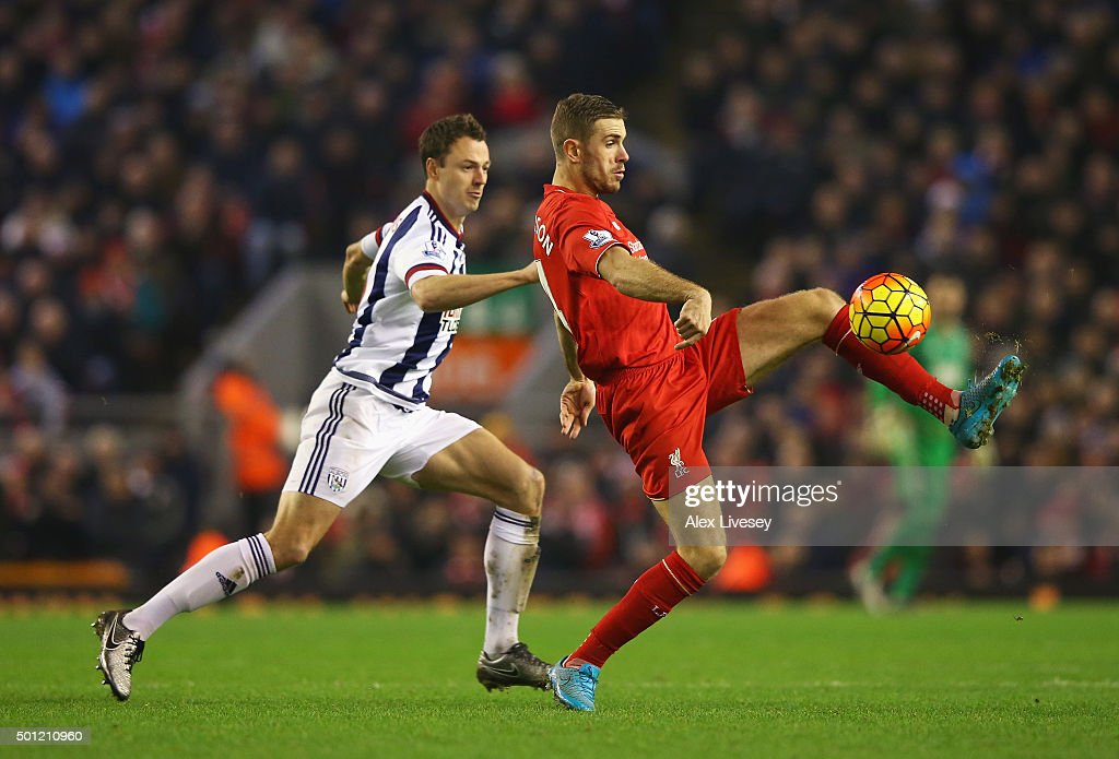 Jordan Henderson of Liverpool controls the ball from Jonny Evans of West Bromwich Albion during the Barclays Premier League match between Liverpool and West Bromwich Albion at Anfield on December 13, 2015 in Liverpool, England.