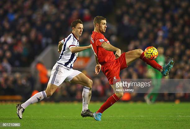 Jordan Henderson of Liverpool controls the ball from Jonny Evans of West Bromwich Albion during the Barclays Premier League match between Liverpool...