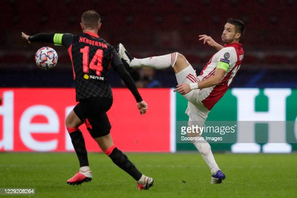 Jordan Henderson of Liverpool Dusan Tadic of Ajax during the UEFA Champions League match between Ajax v Liverpool at the Johan Cruijff Arena on...