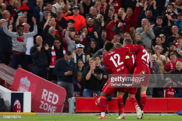 Jordan Henderson of Liverpool FC celebrates after scoring his team's third goal with teammates during the UEFA Champions League group B match between...