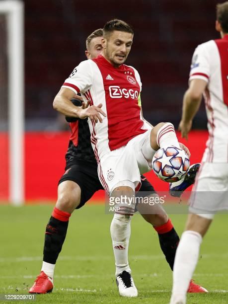 AMSTERDAM Jordan Henderson of Liverpool FC Dusan Tadic of Ajax Daley Blind or Ajax during the UEFA Champions League match in group D between Ajax...