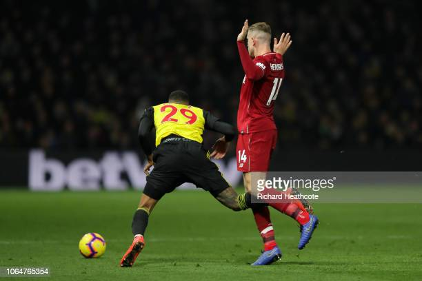 Jordan Henderson of Liverpool fouls Etienne Capoue of Watford leading to a red card during the Premier League match between Watford FC and Liverpool...