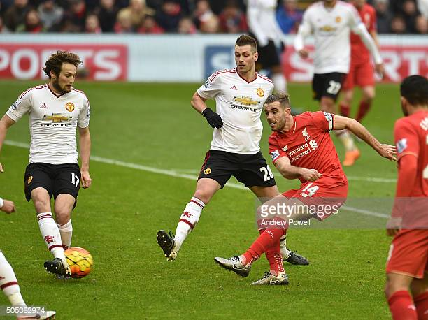 Jordan Henderson of Liverpool has a shot at goal during the Barclays Premier League match between Liverpool and Manchester United at Anfield on...