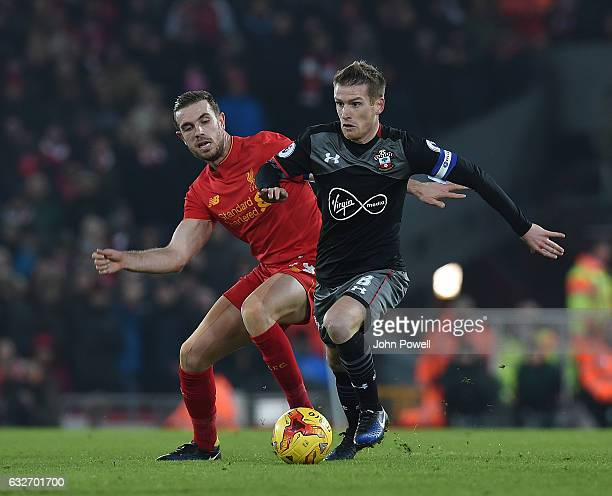 jordan Henderson of Liverpool in action with Jack Stevens of Southampton during the EFL Cup SemiFinal second leg match between Liverpool and...