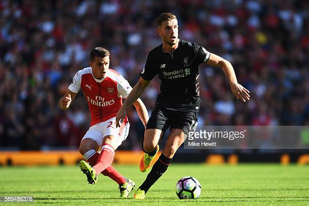 Jordan Henderson of Liverpool is closed down by Granit Xhaka of Arsenal during the Premier League match between Arsenal and Liverpool at Emirates...